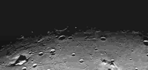 Craters and fissures (fossae) on Charon photographed during the flyby. Credit: NASA/Johns Hopkins University Applied Physics Laboratory/Southwest Research Institute