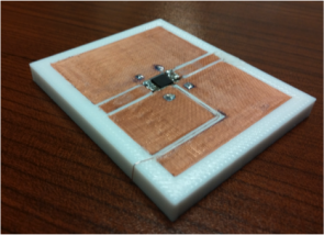 In one line of research, Hao Xin's team is developing 3-D printing solutions to the challenges of combining different materials, as in this coplanar waveguide, a device that is used to transmit microwave-frequency signals. Image credit: Hao Xin