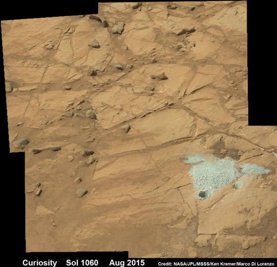 Curiosity rover successfully drills into Martian outcrop at Buckskin rock target at current work site at base of Mount Sharp in August 2015, in this mosaic showing full depth drill hole and initial test hole, with grey colored subsurface tailings and mineral veins on surrounding Red Planet terrain. This high resolution photo mosaic is a multisol composite of color images taken by the mast mounted Mastcam-100 color camera up to Sol 1060, July 31, 2015. Credit: NASA/JPL-Caltech/Ken Kremer/Marco Di Lorenzo
