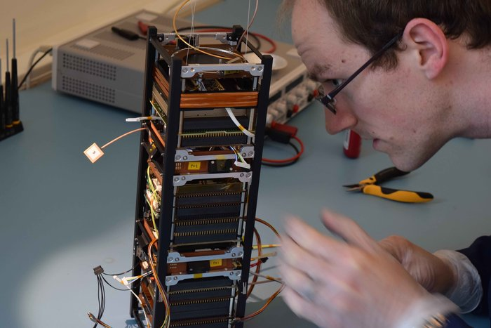 The technology-testing GomX-3 under construction. It has been developed for ESA by GomSpace in Aalborg, Denmark, which is one of Europe's main CubeSat manufacturers. A 'three-unit' CubeSat, it measures 10x10x30 cm in size with an approximate mass of 3 kg, with payloads to detect signals from aircraft and telecom satellites. Copyright https://davidgerhardt.com