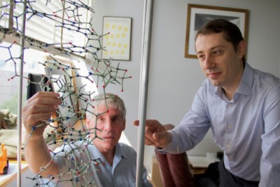 Bogdan Fedeles (right), a research associate in the MIT Department of Biological Engineering and lead author on a new paper on the link between chronic inflammation and cancer, examines a DNA model with professor John Essigmann, who led the current research. Photo: Jose-Luis Olivares/MIT