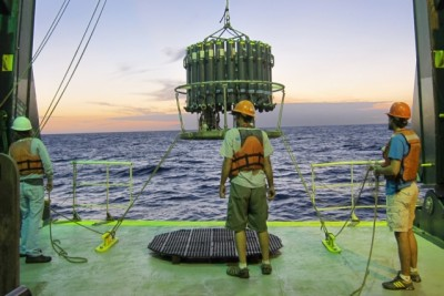 Researchers deploy the Niskin bottle rosette that is used for collecting the thorium samples at sunset. Courtesy of Christopher Hayes