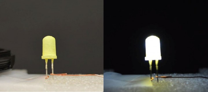 """An LED coated with a yellow """"phosphor"""" is shown turned off (left) and then turned on (right). This """"green"""" LED is inexpensive and provides warm white light. Credit: Zhichao Hu, Ph.D."""