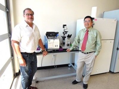 Optokey's Robert Chebi (left) and Frank Chen are commercializing a nanoscale sensor developed at Berkeley Lab. Image credit: Julie Chao