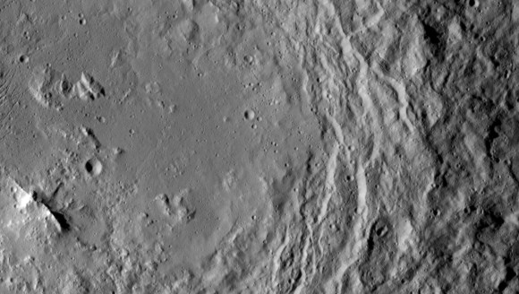 This image, taken by NASA's Dawn spacecraft, shows high southern latitudes on Ceres from an altitude of 2,700 miles (4,400 kilometers). Zadeni crater, measuring about 80 miles (130 kilometers) across, is on the right side of the image. Credit: NASA/JPL-Caltech/UCLA/MPS/DLR/IDA