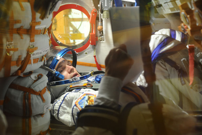 ESA astronaut Andreas Mogensen is pictured during a 'fit-check' of the Soyuz TMA-18M spacecraft. On 2 September, the Soyuz will carry Andreas and crewmates Sergei Volkov and Aidyn Aimbetov to the International Space Station. As part of their preparations for the launch the crew inspect their spacecraft. Copyright Energia