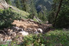 A view down from the headscarp of a debris flow in Boulder Canyon. The landslide removed about 20 inches of sediment from the slope, and scoured to bedrock on its path to flooding Boulder Creek. Image credit: Bob Anderson.