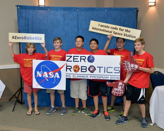 The top Texas team from Spillane Middle School celebrates writing code for the International Space Station during the Zero Robotics Middle School Finals. Credits: NASA/James Blair