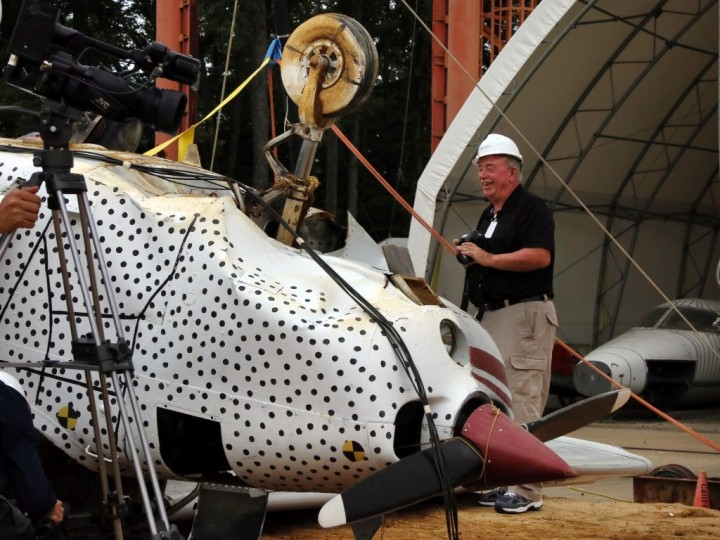 Bill Corbett looks over the wreckage of his old airplane after the test. Credits: NASA/David C. Bowman