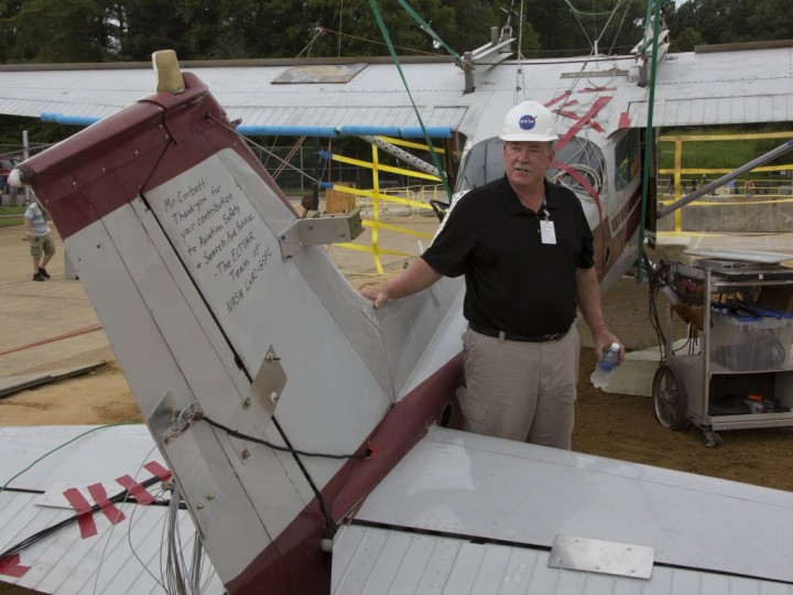 """Bill Corbett, who used to fly this Cessna 172 as a fish spotter for the commercial fishing industry, was on hand Wednesday to watch his former aircraft used for research at NASA Langley. Researchers dropped the plane 100 feet in order to collect crash test data on its emergency locator transmitters. A note on the vertical tail of the plane from NASA's Emergency Locator Transmitter Survivability and Reliability team reads: """"Mr. Corbett. Thank you for your contribution to aviation safety and search and rescue — The ELTSAR team at NASA LaRC-GSFC."""" Credits: NASA/David C. Bowman"""