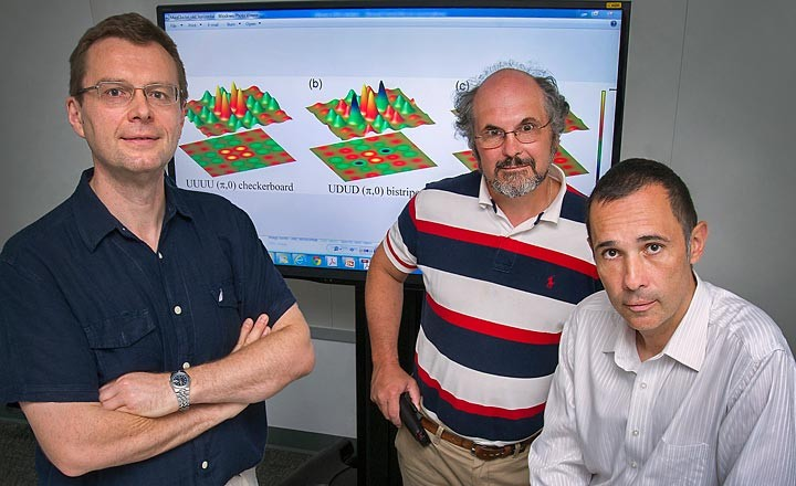 Left to right: Brookhaven physicists Igor Zaliznyak, Alexei Tsvelik, and Cedomir Petrovic with models representing electron spin correlations in an iron-based superconductor.