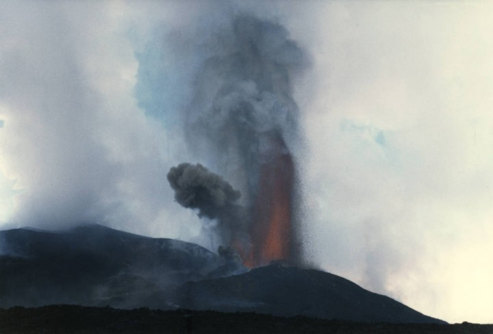 A small fire fountain eruption during the 1989 eruption of Mount Etna, Italy. A plume of fragmented ash and gas rises buoyantly above the red hot lava in the fountain. Credits: Lori Glaze