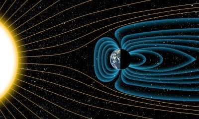 An artist's depiction of Earth's magnetic field deflecting high-energy protons from the sun four billion years ago. Note: The relative sizes of the Earth and Sun, as well as the distances between the two bodies, are not drawn to scale. Image credit: Michael Osadciw/University of Rochester