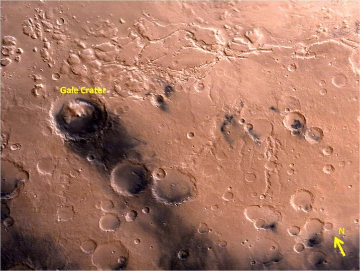 Gale Crater – landing site of NASA's Curiosity rover – and vicinity as seen by India's Mars Orbiter Mission from an altitude of 9004 km. Gale crater is home to humongous Mount Sharp which rises 5.5 km from the crater floor and is easily visible in this photo. Credit: ISRO
