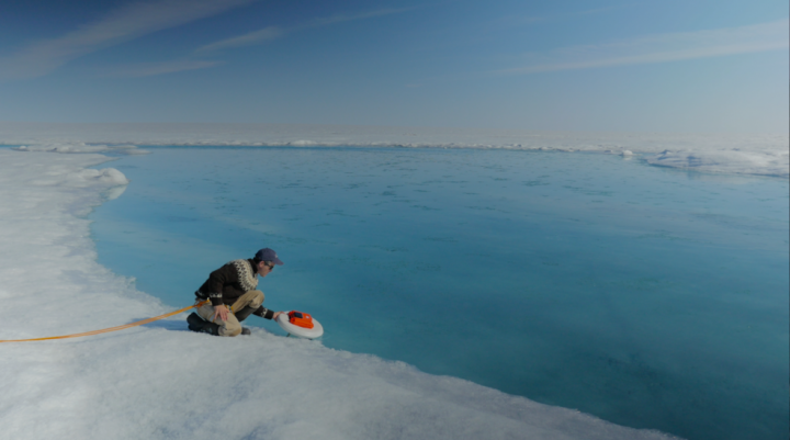 Laurence Smith, chair of geography at University of California, Los Angeles, deploys an autonomous drift boat equipped with several sensors in a meltwater river on the surface of the Greenland ice sheet on July 19, 2015. Credits: NASA's Goddard Space Flight Center/Jefferson Beck