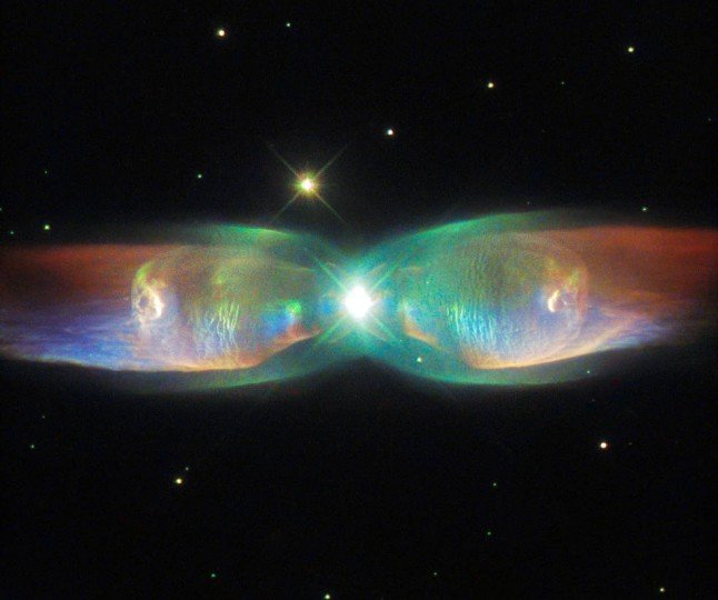 The shimmering colors visible in this NASA/ESA Hubble Space Telescope image show off the remarkable complexity of the Twin Jet Nebula. Credits: ESA/Hubble & NASA, Acknowledgement: Judy Schmidt