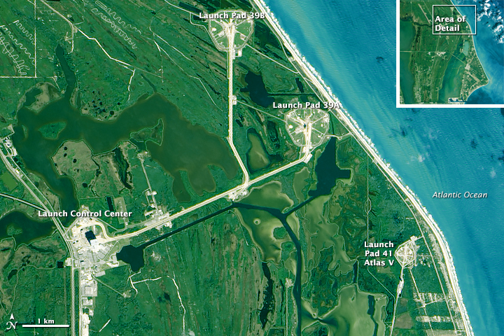 Crashing waves and sandy shoreline are not far from the launchpads at Kennedy Space Center. That distance is decreasing each year. (NASA Earth Observatory image by Joshua Stevens, using Landsat data from the U.S. Geological Survey)