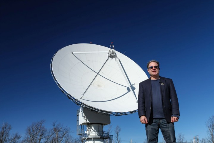 Morehead State University professor Ben Malphrus, who is leading the Lunar IceCube mission, stands in front of the university's 21-meter ground station antenna that will be handling the mission's communications needs. Credits: Randy Evans/Dataseam