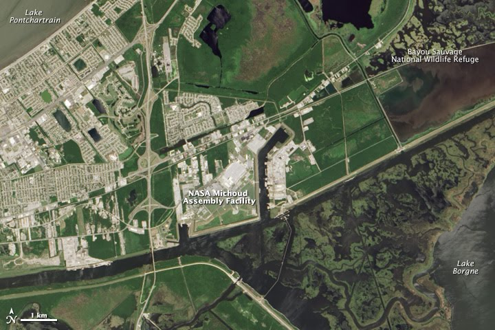 Situated in the bayous and marshes of the Mississippi Delta, Michoud Assembly Facility is experiencing significant ground subsidence that exacerbates sea level rise. (NASA Earth Observatory image by Jesse Allen, using Landsat data from the U.S. Geological Survey)