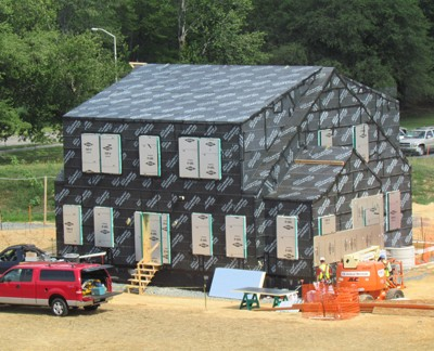 During construction, NIST's net-zero energy house was wrapped in a continuous membrane to seal out air and moisture, which greatly reduced heating and cooling loads. But nearly eliminating unintended air infiltration required NIST to take deliberate steps to achieve a high quality indoor environment. Image credit: NIST