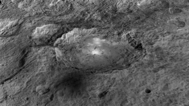 The intriguing brightest spots on Ceres lie in a crater named Occator, which is about 60 miles (90 kilometers) across and 2 miles (4 kilometers) deep. Credits: NASA/JPL-Caltech/UCLA/MPS/DLR/IDA/LPI