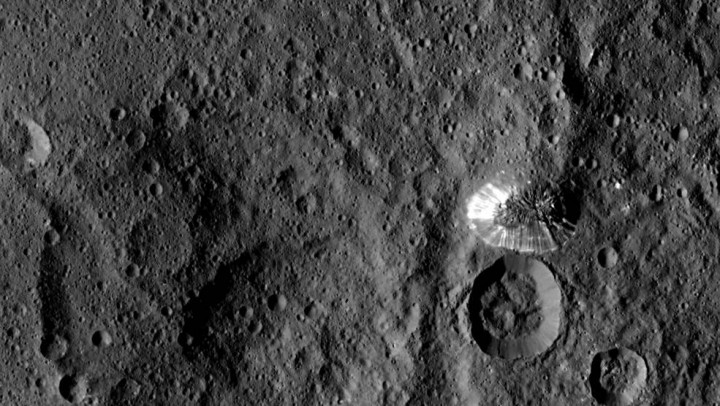 NASA's Dawn spacecraft spotted this tall, conical mountain on Ceres from a distance of 915 miles (1,470 kilometers). The mountain, located in the southern hemisphere, stands 4 miles (6 kilometers) high. Its perimeter is sharply defined, with almost no accumulated debris at the base of the brightly streaked slope. Credits: NASA/JPL-Caltech/UCLA/MPS/DLR/IDA