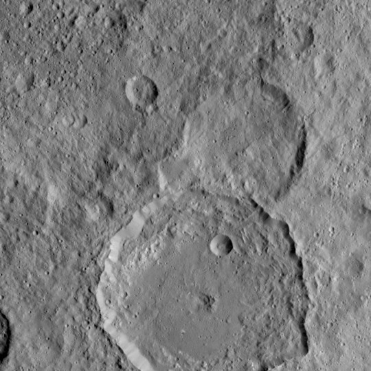NASA's Dawn Spacecraft took this image of Gaue crater, the large crater on the bottom, on Ceres. Gaue is a Germanic goddess to whom offerings are made in harvesting rye. Credits: NASA/JPL-Caltech/UCLA/MPS/DLR/IDA