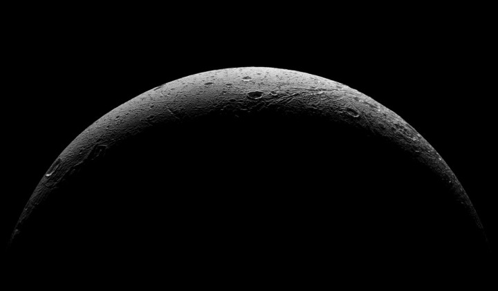 NASA's Cassini spacecraft captured this parting view showing the rough and icy crescent of Saturn's moon Dione following the spacecraft's last close flyby of the moon on Aug. 17, 2015. Credits: NASA/JPL-Caltech/Space Science Institute