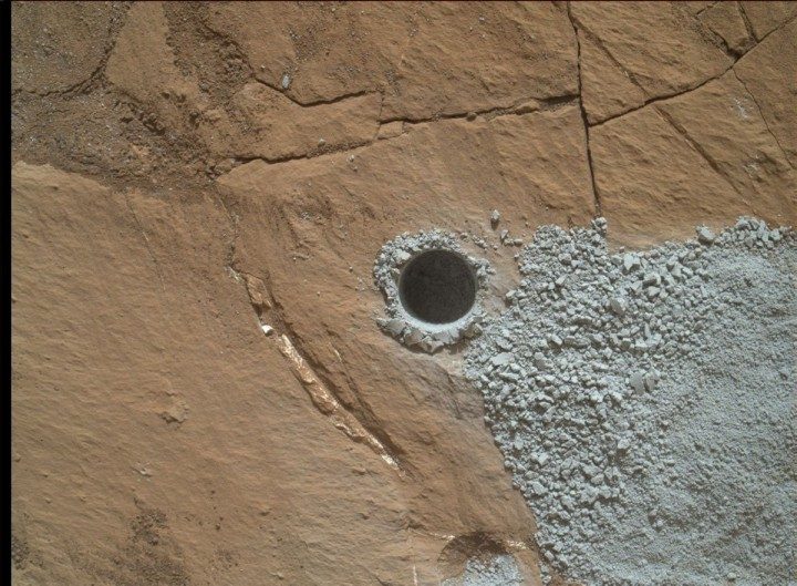 """NASA's Curiosity Mars Rover drilled this hole to collect sample material from a rock target called """"Buckskin"""" on July 30, 2015, about a week prior to the third anniversary of the rover's landing on Mars. The diameter is slightly smaller than a U.S. dime. Credits: NASA/JPL-Caltech/MSSS"""