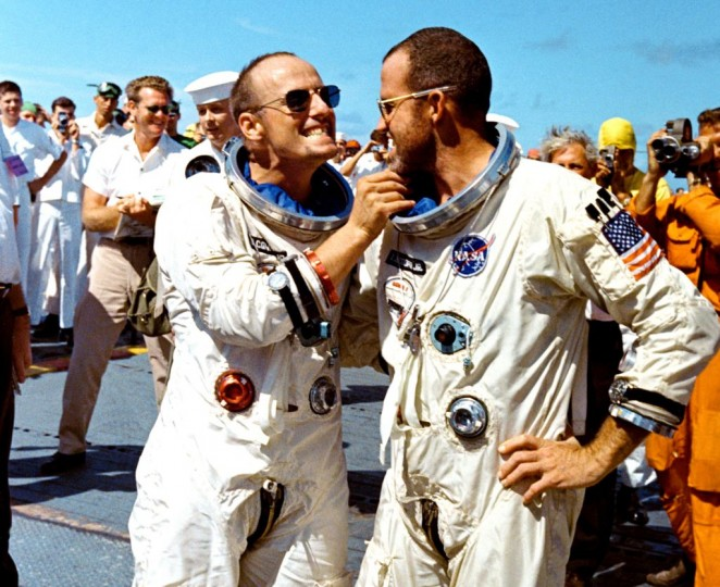 "After recovery by the crew of the USS Lake Champlain on Aug. 29, 1965, Gemini V pilot Charles ""Pete"" Conrad tweaks the eight-day growth of beard of command pilot Gordon Cooper. Credits: NASA"