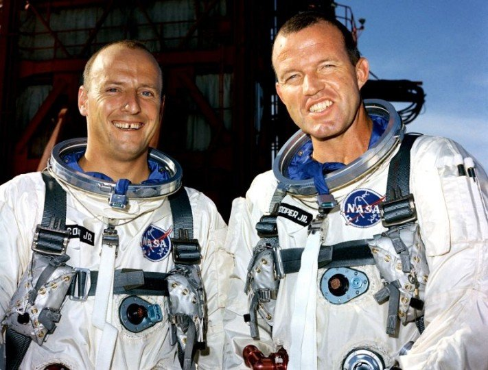 "Gemini V pilot Charles ""Pete"" Conrad, left, and command pilot Gordon Cooper stand in front of Cape Kennedy's Launch Pad 19 during a training exercise on Aug. 16, 1965. Credits: NASA"