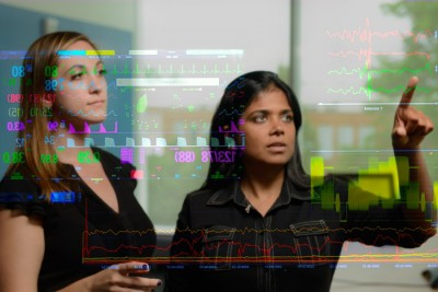 Study authors Katharine Henry (left) and Suchi Saria analyze data from critically ill patients. Image credit: Will Kirk