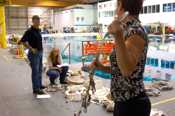 Stephanie Johnston, crouching, does a tool check with astronauts Whitson and Shane Kimbrough before a Neutral Buoyancy Laboratory training session.