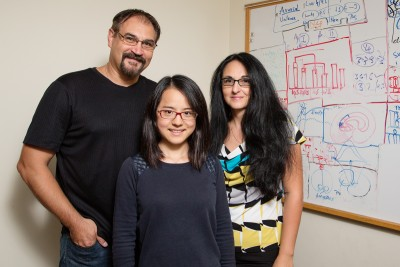 From left, U. of I. psychology professor Florin Dolcos, graduate student Yifan Hu, researcher Sanda Dolcos and their colleagues found that healthy adults who have a larger orbitofrontal cortex, a brain region located just behind the eyes, are more optimistic and less anxious. Photo credit: L. Brian Stauffer