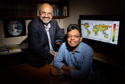 Atmospheric sciences professor Atul Jain and graduate student Prasanth Meiyappan found that most carbon emissions models overestimate the capacity of regrowing forests to take in carbon. Despite a projected abundance of photosynthesis-fueling carbon, nitrogen is limited, thus limiting forests' growth. Photo credit: L. Brian Stauffer