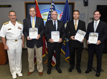 150826-N-PO203-101 ARLINGTON, Virginia (August 26, 2015) Rear Adm. Mat Winter, chief of naval research, presents the Office of Naval Research (ONR) 2014 Prize for Affordability to Naval Research Laboratory employees, from left, John Wegand, Paul Slebodnick, James Martin, and Dr. Eric Iezzi, during an awards ceremony held at ONR in Arlington, Va. (U.S. Navy photo by John F. Williams/Released)