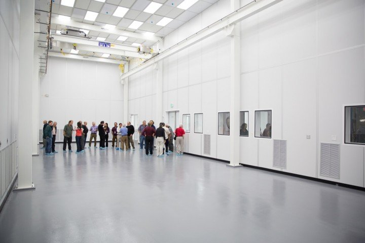 Visitors inspect SLAC's newest clean room, which will serve as the assembly area for the 3.2-gigapixel camera of the LSST. (SLAC National Accelerator Laboratory)