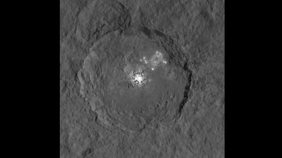 Bright spots in the interior of Occator Crater. This image was acquired by the Dawn spacecraft from an altitude of 1470 kilometers. The enigmatic light spots in the crater's interior are significantly brighter then their surroundings and are frequently overexposed., so two images with differentexposure times have been superimposed to produce this view. The resolution is 140 metres per pixel. Photo credit: NASA
