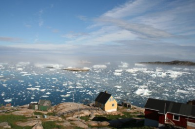 A village on the coast of Greenland, where the native Inuit population traditionally ate diets high in omega-3 fats. Over thousands of years, they developed genetic mutations that allowed them to remain healthy despite the fatty died, but this adaptation had other consequences, such as short height. Image credit: Malik Milfeldt