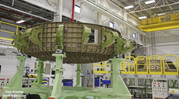 First view of the Boeing CST-100 'Starliner' crewed space taxi at the Sept. 4, 2015 Grand Opening ceremony held in the totally refurbished C3PF manufacturing facility at NASA's Kennedy Space Center. These are the upper and lower segments of the first Starliner crew module known as the Structural Test Article (STA) being built at Boeing's Commercial Crew and Cargo Processing Facility (C3PF) at KSC. Credit: Ken Kremer