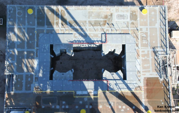 Looking down to the enlarged 64 foot wide exhaust hole from the top of NASA's 380 foot-tall Mobile Launch tower. Astronauts will board the Orion capsule atop the Space Launch System (SLS) rocket for launches from Space Launch Complex 39B the Kennedy Space Center in Florida. Credit: Ken Kremer