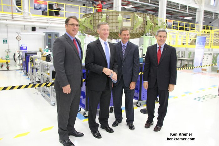 Boeing and NASA managers pose with the Boeing CST-100 Starliner crew module being assembled into the Structural Test Article at company's C3PF facility at the Kennedy Space Center in Florida. From left are John Mulholland, Boeing Vice President Commercial Programs; Chris Ferguson, former shuttle commander now Boeing deputy manager Commercial Crew Program; John Elbon, Boeing vice president and general manager of Space Exploration; and Robert Cabana, former shuttle commander and now Director NASA's Kennedy Space Center, on Sept. 4, 2015. Credit: Ken Kremer