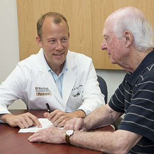 Eric J. Lenze, MD, consults with patient Daniel Viehmann. Lenze led a multicenter study that found that adding a second drug can relieve depression in many older adults whose symptoms don't resolve after treatment with a standard antidepressant drug. Image credit: Robert Boston