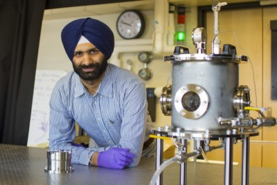 Postdoc Navdeep Singh Dhillon (pictured) studies the fundamental physical mechanisms that dictate the boiling crisis phenomenon. At right is a rig for measuring the critical heat flux (CHF) of thermally saturated water boiling on thin textured substrates, which allows researchers to visualize bubbles and measure real-time spatial substrate temperatures using infrared imaging. Photo credit: Jose-Luis Olivares/MIT