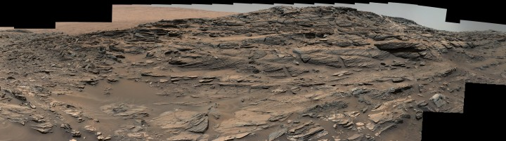 Large-scale crossbedding in the sandstone of this ridge on a lower slope of Mars' Mount Sharp is typical of windblown sand dunes that have petrified. NASA's Curiosity Mars rover used its Mastcam to capture this vista on Aug. 27, 2015, Sol 1087. Similarly textured sandstone is common in the U.S. Southwest. Credits: NASA/JPL-Caltech/MSSS