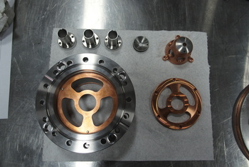 These components, part of Phoenix's neutron generator, will extract ions so they can be accelerated to high velocity in an intense electric field. Image credit: Phoenix Nuclear Labs