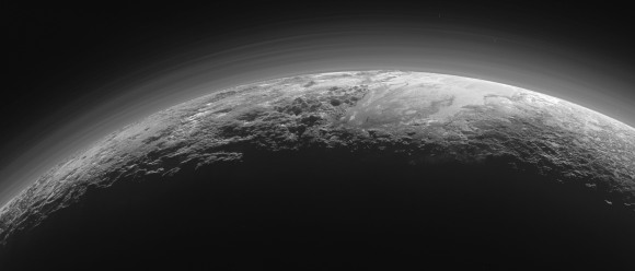Only 15 minutes after its closest approach to Pluto on July 14, 2015, NASA's New Horizons spacecraft looked back toward the sun and captured this near-sunset view of the rugged, icy mountains and flat ice plains extending to Pluto's horizon. The smooth expanse of the informally named icy plain Sputnik Planum (right) is flanked on the left by rugged mountains up to 11,000 feet (3,500 meters) high, including the informally named Norgay Montes in the foreground and Hillary Montes on the skyline. To the right, east of Sputnik, rougher terrain is cut by apparent glaciers. The backlighting highlights over a dozen layers of haze in Pluto's tenuous but distended atmosphere. The image was taken from a distance of 11,000 miles (18,000 km). Be sure to click for a large version to better see the details described. Credits: NASA/JHUAPL/SwRI