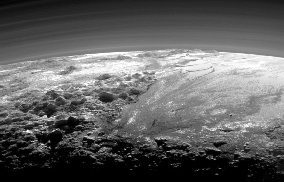 Just look at those pyramidal mountain peaks right next to those relatively smooth, icy plains. The backlighting highlights more than a dozen layers of haze in Pluto's tenuous but distended atmosphere. The image was taken from a distance of 11,000 miles (18,000 km) to Pluto; the scene is 230 miles (380 km) across. Credits: NASA/JHUAPL/SwRI)