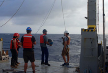 U.S. and Indian scientists aboard the research vessel Roger Revelle deploy a wave buoy to measure upper ocean density and velocity in the Bay of Bengal. The month-long mission aboard the Office of Naval Research-owned vessel centered on monsoon prediction. (Photo courtesy of the R/V Roger Revelle)