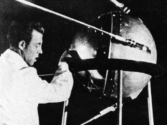 Photograph of a Russian technician putting the finishing touches on Sputnik 1, humanity's first artificial satellite. Credit: NASA/Asif A. Siddiqi